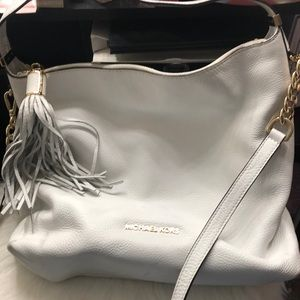 White Michael Kors purse.